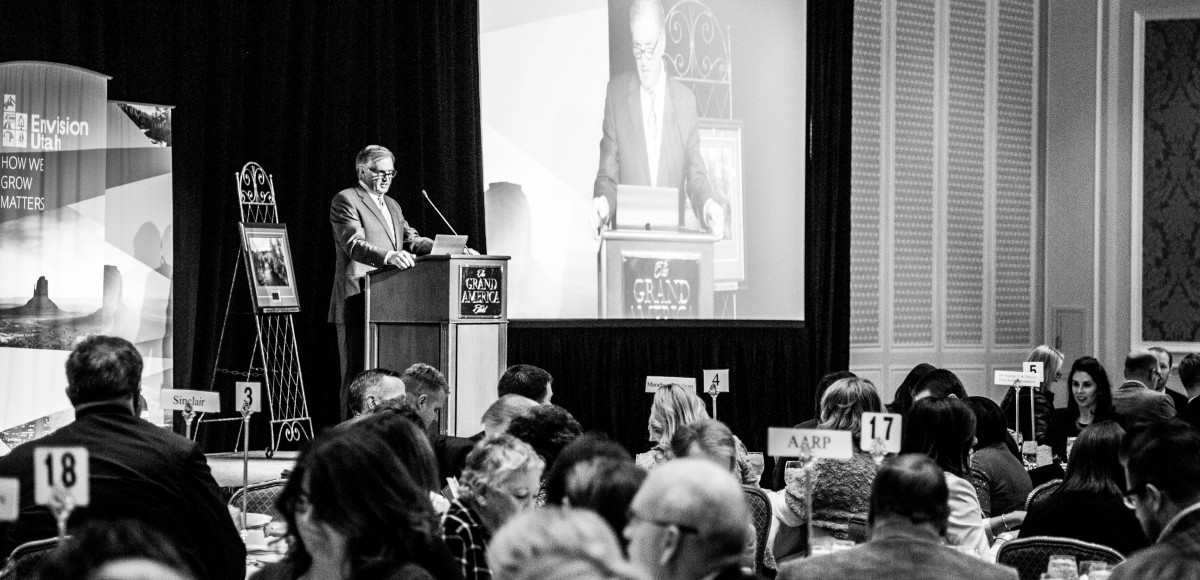 Jacobsen Construction Board of Directors Chairman Lonnie Bullard is pictured at the 2019 Common Good Awards luncheon at the Grand America Hotel in Salt Lake City. Bullard, who is also the chairman of Envision Utah's Executive Committee, emceed the luncheon. Photo credit: Envision Utah