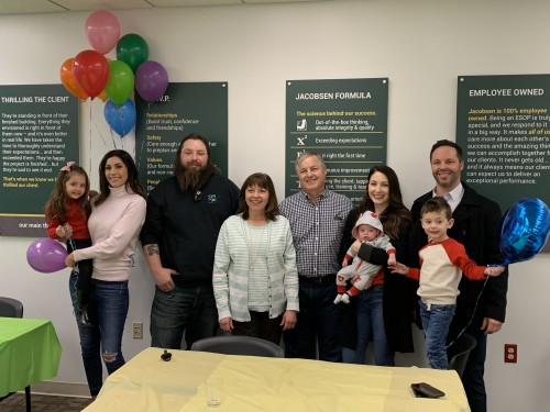 Ron McCann is pictured with his family at his retirement celebration.